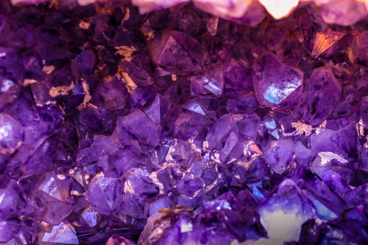 closeup photo of purple gemstones