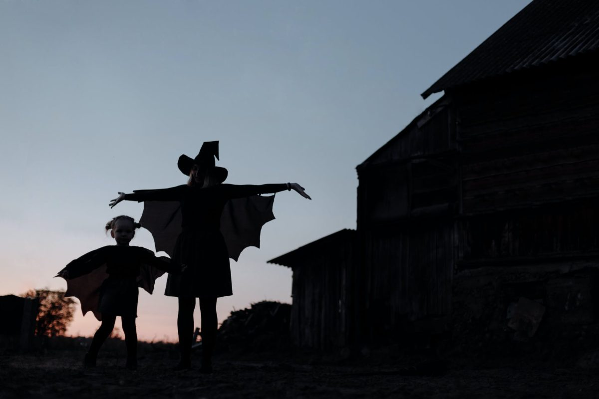 silhouette of witch mom and daughter