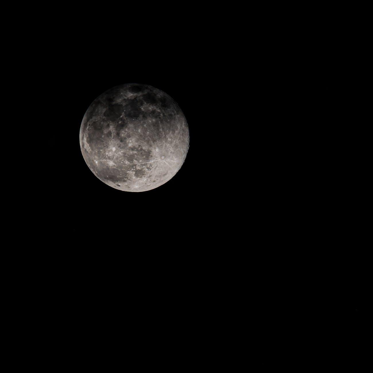 full moon shining on black background