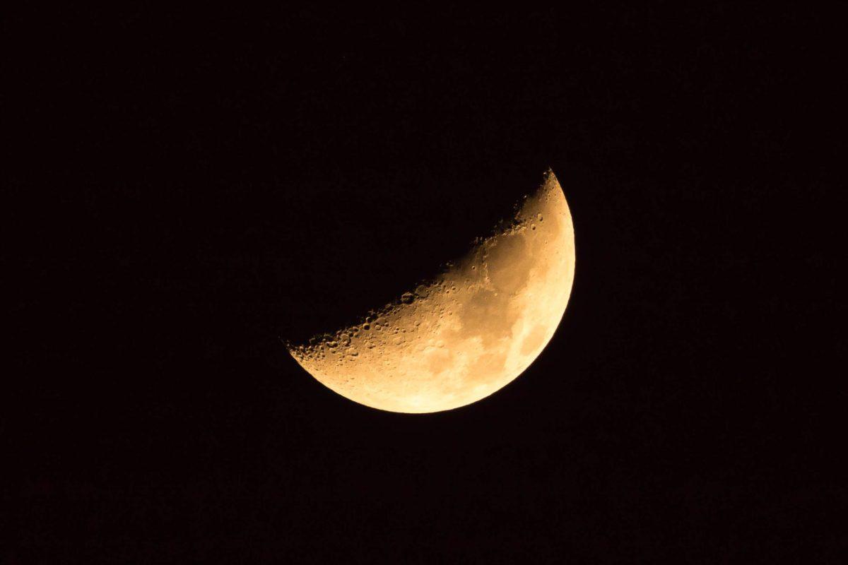 glowing yellow moon on black sky
