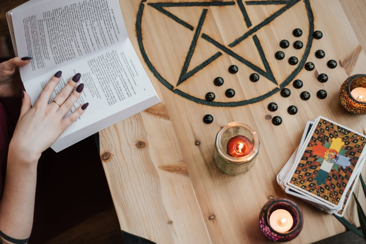 faceless soothsayer reading magic book while predicting fate
