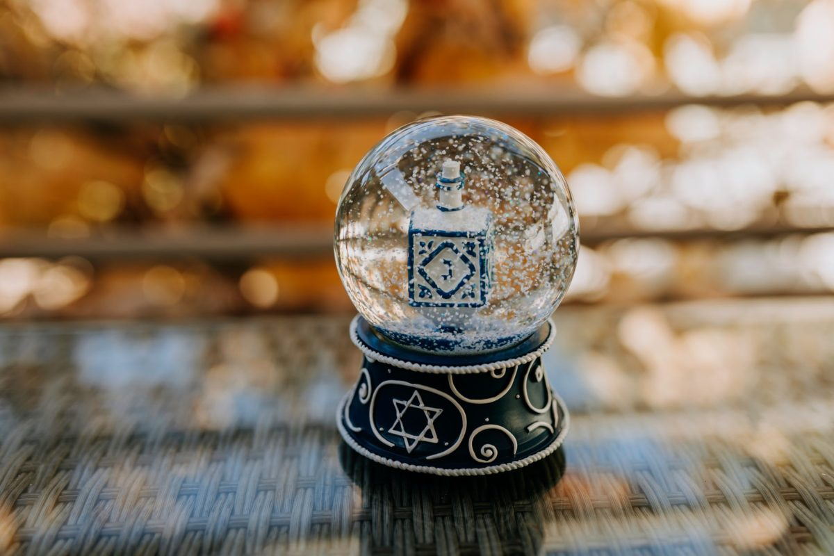 close up photo of snow globe on top of glass table