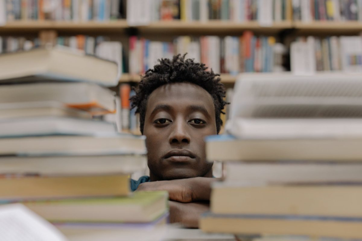 man behind books
