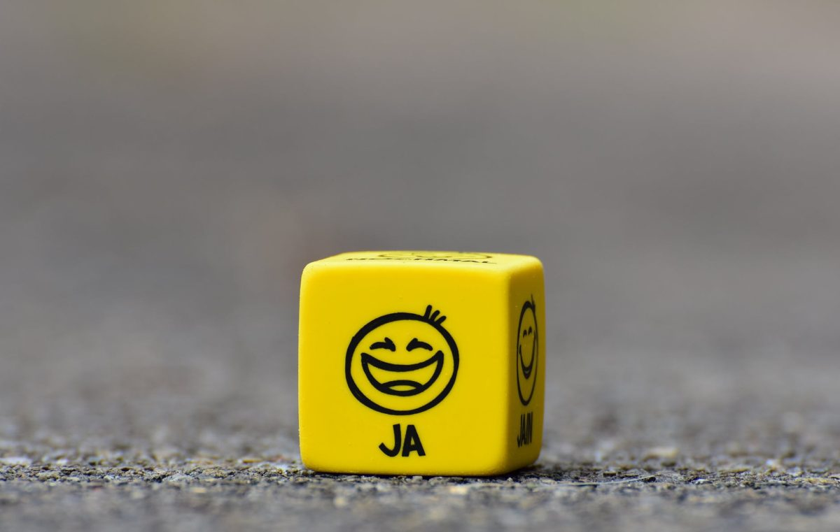 yellow cube on brown pavement