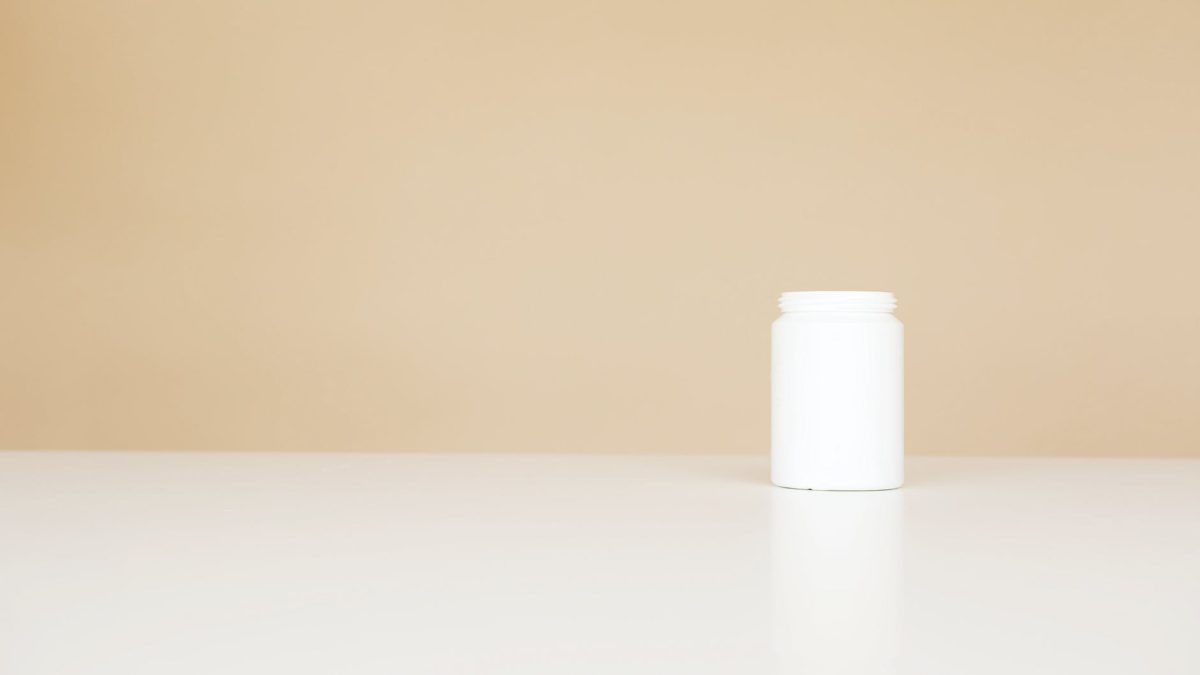 white bottle for pills on table