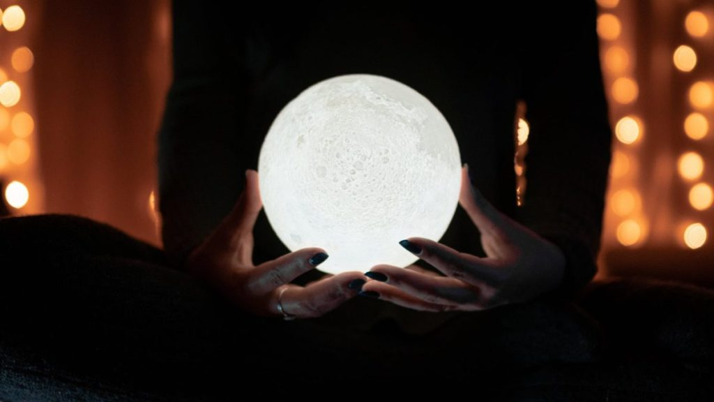 white moon on hands