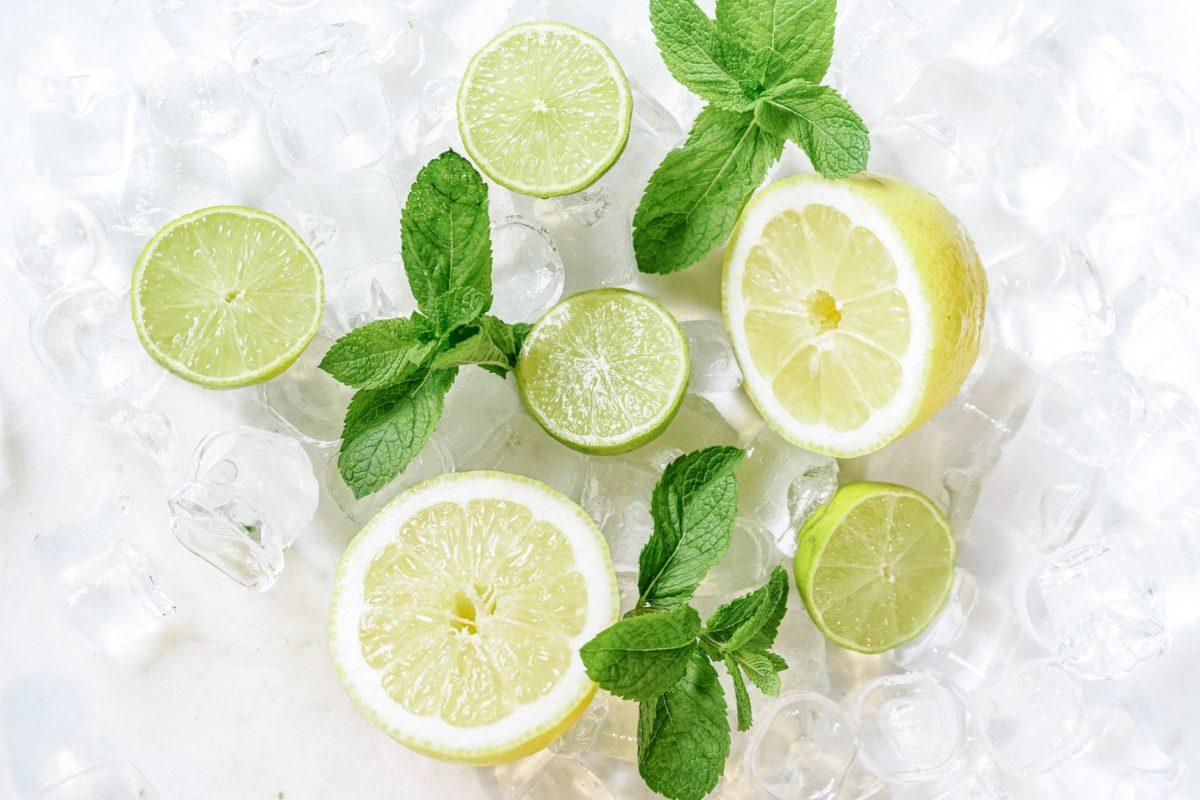 iced sliced lemon on clear drinking glass